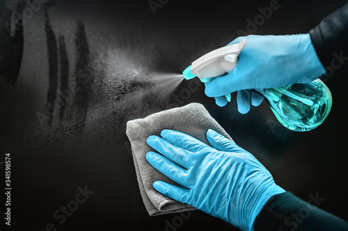 Canvastavla Surface cleaning disinfecting home with sanitizing antibacterial wipes protection against COVID-19 spreading wearing medical blue gloves