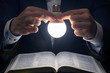 canvas print picture - man reads the holy bible in the light of the LED lamp on. the search for God and the study of the book. Christianity and religion