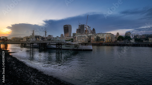 Canvas HMS Belfast warship and a view across the River Thames to the financial District