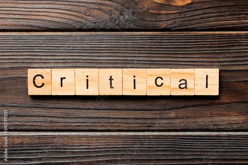 critical word written on wood block Slika na platnu