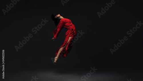 Fotografering Contemporary dancer dancing on studio background