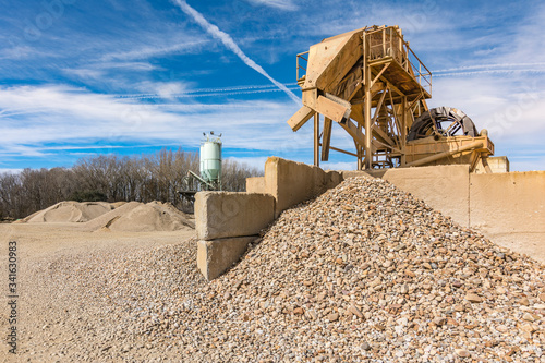 Photo Quarry aggregate with heavy duty machinery.