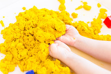 Yellow Magic Sand In A Kids Ha...