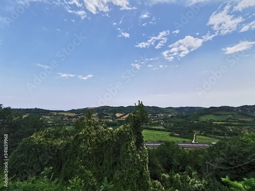 Photo panorma of the green hills near the adda river