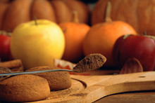 Cookies With Pumpkins And Apples On The Table With Full Spoon Of Cacao