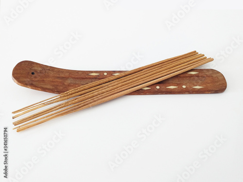 Aerial view of natural incense sticks on rectangular wooden censer isolated on white background Canvas Print