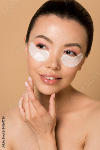 Fototapety, obrazy: attractive tender naked asian girl with collagen eye pads isolated on beige