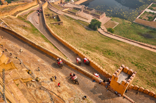 Tourists riding elephants on ascend to Amer (Amber) fort, Rajasthan, India Wallpaper Mural