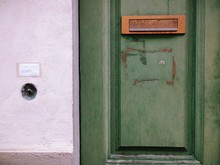 Close-up Of Green Door With Mail Slot