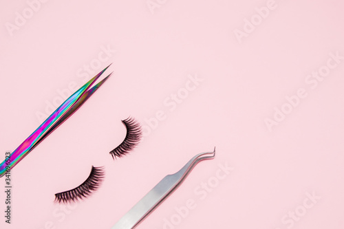 Fototapeta Set for eyelash extension on a pink background
