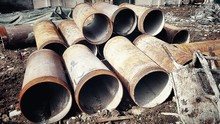 Old Rusty Water Pipes At Construction Site