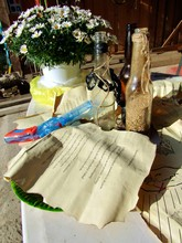 A Table Full Of Old-looking Papers And Props From Finding Treasure From A Children's Birthday Party