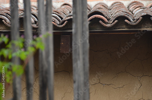 Canvas Print Wooden Fence Against House