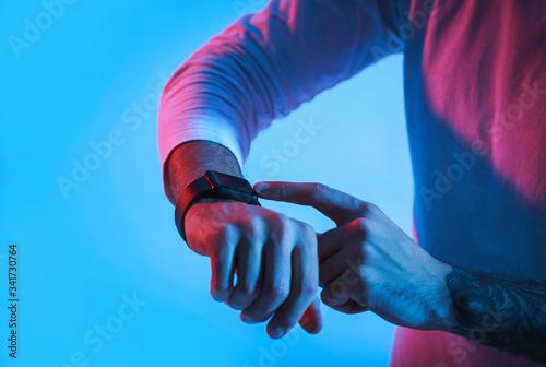 Fényképezés Modern technology for people. Man controls smartwatch