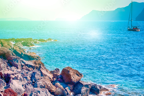 People Traveling on Sailing Boat as Tourist Attraction at Santorini Island in Greece At Daytime Wallpaper Mural