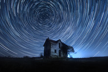Abandoned House Under Star Tra...