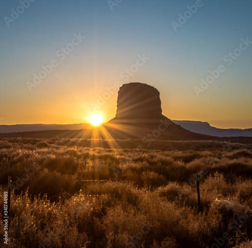 Fotografie, Obraz Rock Formation At Monument Valley Against Clear Sky At Sunrise