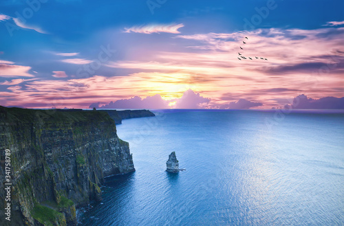 Fényképezés Cliffs Of Moher By Sea Against Sky During Sunset