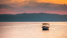 Empty Abandoned Boat On Lake -...