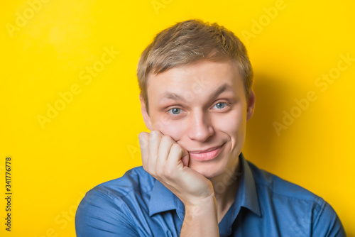 Fototapeta Blond young man thinks thinks