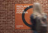 Glued Poster Mockup on Brick Wall with Woman in Foreground - 341787156
