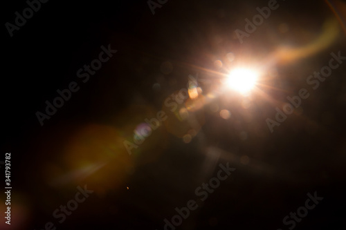 Abstract Natural Sun flare on the black background. Wallpaper Mural