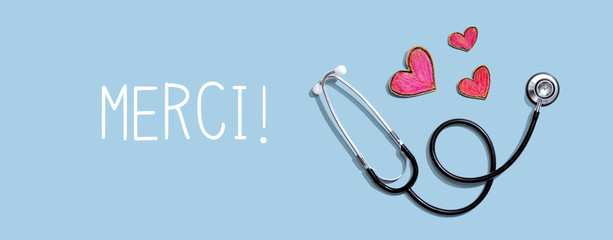 Merci - Thank you in french language with stethoscope and hand drawing hearts