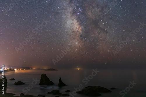 Milky Way Galaxy shining above Bandon Beach as fog comes ashore in Oregon Canvas Print
