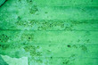 Leinwanddruck Bild - Fragment of old house wall close-up. Green background. Peeling plaster on concrete surface. tinted green. Cracks in paint. Copy space. Place for text.