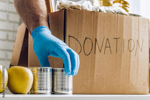 Fotomural Donation box of food for people suffering from coronavirus pandemia consequences