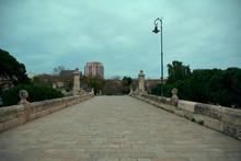 Old Stone Bridge In A Big City