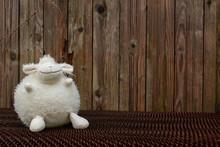 A Lone White Plush Lamb Sits O...