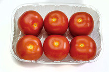 Six Tomatoes In A Plastic Cont...