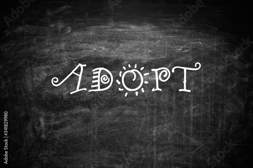 Word ADOPT written with chalk on blackboard, top view Canvas Print