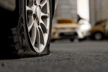 Car Tire With A Flat Tire In T...