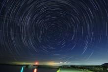 Spiral Star Trails Over Sea