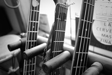 Close-up Of Guitars By Window At Home