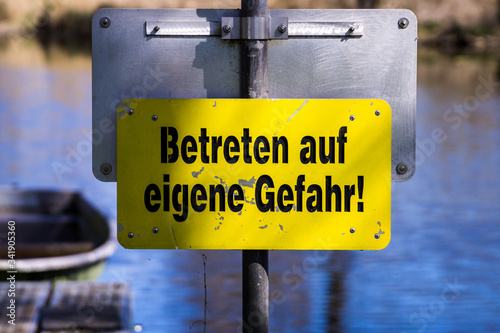Canvas Print yellow sign enter at your own risk