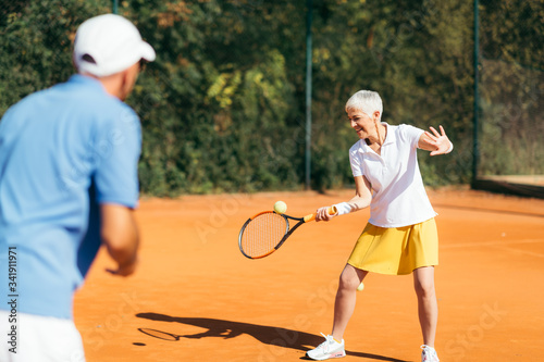 Fotografia Mature Woman Playing Tennis