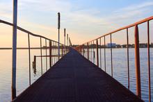 Iron Footbridge Over The Lake