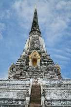 Low Angle View Of Chedi Phukhao Thong Against Cloudy Sky