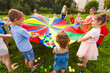 Cheerful children playing outdoors at birthday party