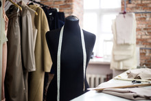Fashion Creative Design Studio Interior Concept With Mannequin Dummy And Stylish Fashionable Trendy Clothes On Hangers, Dressmaking Workplace, Tailor Shop, Sewing Workshop