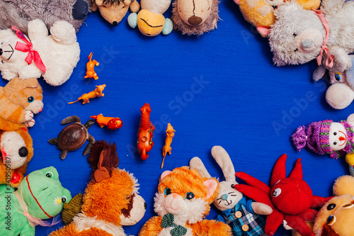 Fototapety, obrazy: lots of baby soft toys for developing boy games on a blue background