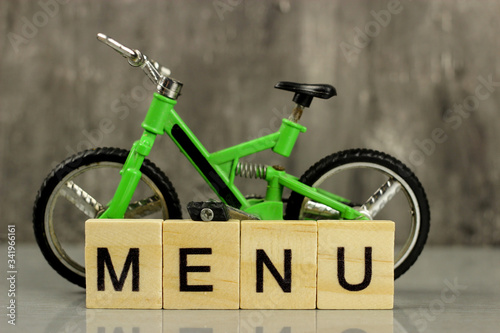 Toy model - full-suspension mountain bike on a gray background and word Menu фототапет