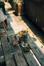 High Angle View Of Flowers In Vase On Table At Cafe