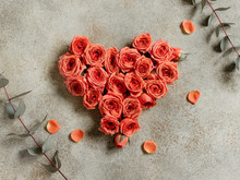 Heart Is Made From Fresh Mini Coral Roses On A Beige Textured Background.