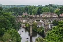 Railway Bridge Over River Amidst Trees At Knaresborough