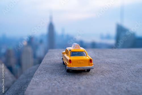 Yellow taxi cabs ride throguh New York City, USA. Taxi symbol. Fototapeta