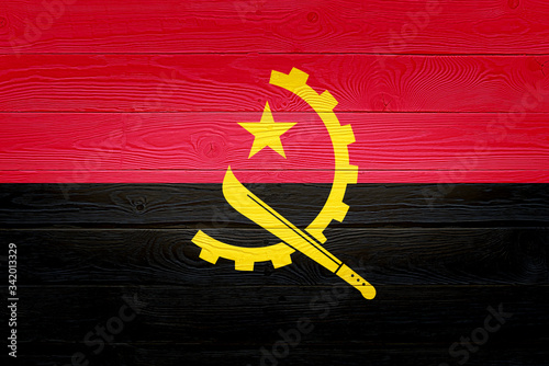 Angola flag painted on old wood plank background Wallpaper Mural